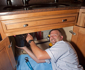 Kirk making plumbing repairs on a sink